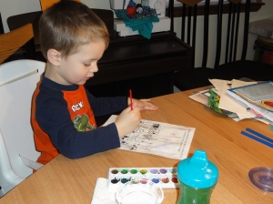 Boy painting watercolors